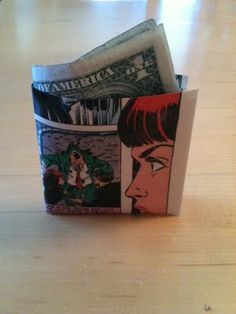 packing tape wallet. use weeded books that have cool pictures. Perfect for using for prizes for the library games!