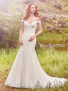 Maggie Sottero Afton. The perfect union of sweetness and sophistication, this fit-and-flare features cascades of lace appliqu�s, a tulle skirt, and a sweetheart neckline. A V-back and sheer off-the-shoulder sleeves accented in lace complete the romance of this look. Finished with covered buttons over zipper closure.