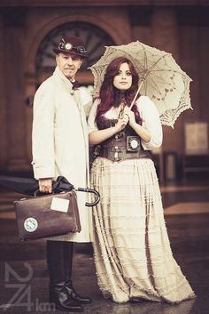Elegant Steampunk Couple - For costume tutorials, clothing guide, fashion inspiration photo gallery, calendar of Steampunk events, & more, visit SteampunkFashionGuide.com