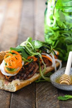 Honey Grilled Pork Banh Mi with Spiralized Pickled Vegetables - Prep ahead for an assemble-and-serve weeknight meal. Quick on time, HUGE on Asian flavor.   foxeslovelemons.com