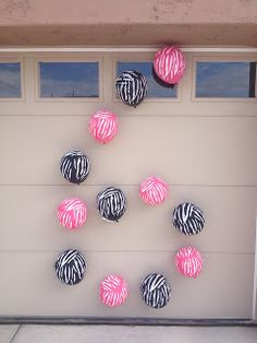 Hang balloons on a garage door to represent the birthday boy/ girl's age. Neat idea! {I think I might do this the day of the party. Which needs to be a Friday. People go to church on Sunday.}