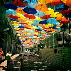 Colorful Umbrellas in Portugal; Agitagueda festival in Portugal, the streets of the city of Agueda Umbrella Cover, Umbrella Art, Piscina Spa, Umbrella Street, Colorful Umbrellas, Parasols, Canopy Cover, Floating, Urban Life