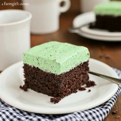 Chocolate Cake with Fluffy Mint Chocolate Chip Buttercream from afarmgirlsdabbles.com