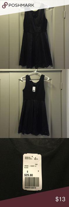 NWT Forever 21 Black Dress Small Forever 21 dress with tags! Has a design cut out on the matte fabric (see pics). Great dress but didn't quite fit me! Forever 21 Dresses