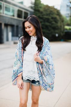 Ultra feminine look featuring a lemon lace top, flowy kimono and distressed denim shorts.