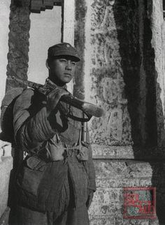 In October 1945, after the war has finally ended, a Chinese Nationalist infantryman stands at the Marco Polo Bridge, where it all began on July 7 1937.