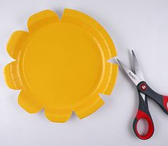 DIY auction paddles/paper plate flowers for centerpiece--all in one!