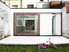 External Space. House W-DR. By Graux & Baeyens Architecten. Textural white washed brick walls.