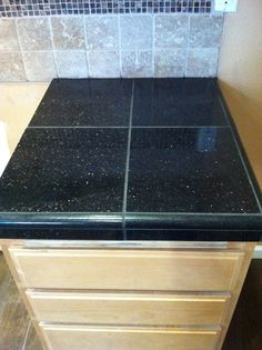 Granite Tile Counter Tops. Do it yourself and save more than half the price than if you do a slab.   This is Black Galaxy Granite. Order by the square foot.   Hardibacker the counters.   Lay out your tiles how you want them.   Make the cuts you need using a tile cutter.  Use thin set (dont forget your spacers)  Allow to set and then grout!     If you can get a buddy who knows tile to help you even better!