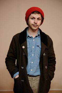 Hip directors love beanies, especially when they are on set and it's drafty.  Cera is a great nerd-turned-cool style example.