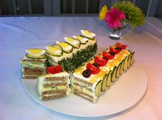 """My Smorgastarta.   The left is smoked salmon and cucumber filling, and the right is egg salad and shredded lettuce. Both tasted very good, although the cream cheese """"frosting"""" tended to overwhelm the ingredients. Something to work on."""