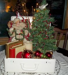 shabby christmas white suitcase w/ a small tree and vintage santa/decor. Great idea.