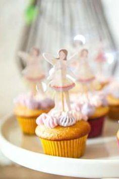 Don't miss this sweet fairy birthday party! The cupcakes are so cute! See more party ideas and share yours at CatchMyParty.com #catchmyparty #partyideas #fairyparty #fairies #fairy