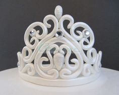 My 1st Tiara.  Made out of fondant.  It measures 4 high and 10 from  one end to the other on the base.  I posted the template I sketched for this Tiara.  I used a 48 oz (3 lb) Crisco vegetable shortening can.  http://cakecentral.com/g/i/2991961/a/3341076
