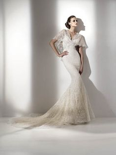 I love this but I think it would make my shoulders look very large.  Beautiful dress though.