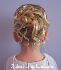Feather Braided Bun #2 (1)idea for Lily's hair for Brooke's wedding