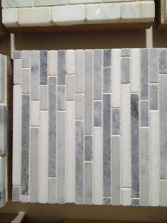 Kitchen: Backsplash Tile - I like the color and interested in the concept of vertical placement...