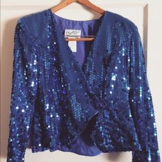 Retro Cobalt Blue Blazer Stunning cobalt blue sequin jacket.   Heads will turn in this!!!  Claralura Originals by Sancor of California   Petite size 6   Note: Outside is in perfect condition. Only flaw is discoloration in inside lining under arms. Picture attached.  Any questions on this stunner message me! Thanks for looking Jackets & Coats Blazers