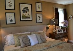 Country bedroom by Staging Concepts  Designs LLC. We are loving the photo frame display over the bed!