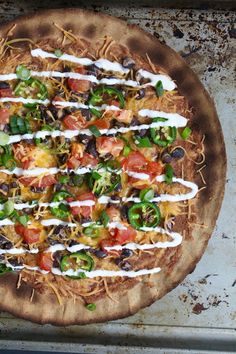Cauliflower Crust Nacho Pizza Recipe -- Two game day classics combined into one delicious (and secretly healthy) pie! | @sinfulnutrition #AD #glutenfree #vegetarian