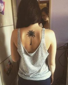 smal palm tree tattoo on back