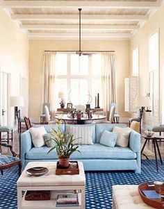 Pillow combos with a light blue couch