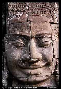Enigmatic stone smiling face, the Bayon. Angkor, Cambodia