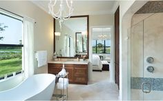 Loving the tub in front of the window and also the tile detailing in the shower