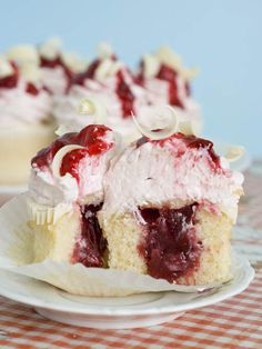 White Chocolate Strawberry Cupcakes are moist and dense vanilla cupcakes with strawberry filling, topped with a layer of white chocolate and strawberry jam