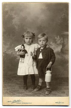 Vintage Photograph- Siblings - little girl holding her little doll.