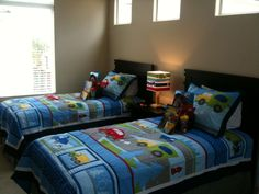 """Your sons will feel right at home in this car themed bedroom. They'll be busy saying """"Vrooooom!"""""""