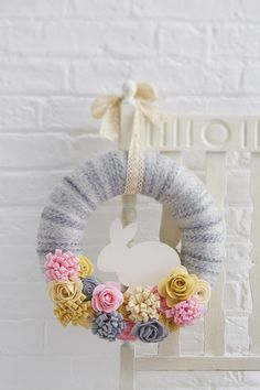 This spring, we've got your front door covered with these Easter wreath ideas. Whether you opt for a cute bunny wreath or a sophisticated floral wreath, you really can't go wrong with these fun DIY projects! Felt Flower Wreaths, Pom Pom Wreath, Felt Wreath, Wreath Crafts, Diy Wreath, Felt Flowers, Diy Crafts, Wreath Ideas, Colorful Flowers