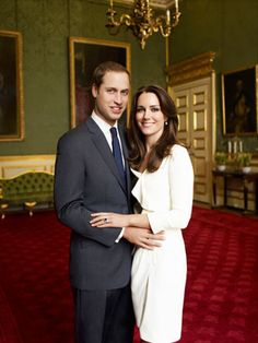 December 12: Kate Middleton and Prince William Pose for Mario Testino  The couple posed for a formal photo in the historic Council Chamber linked to Clarence House, the official residence of William's father, Prince Charles. Kate wore a white Reiss dress and Links earrings and William wore a Turnball and Asser suit.  Photo Credit: Mario Testino