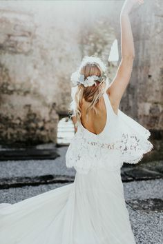Boho flower crown bride in Ireland with lace bohemian wedding dress. Photo by Alex Lasota. Flower Crown by Love Sparkle Pretty with white and cream flowers and eucalyptus leaves http://lovesparklepretty.com/shop/sienna-flower-crown. Ireland destination wedding.