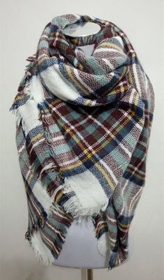 This extra soft scarf is perfect to keep you warm and stylish the whole winter and fall season. This scarf is plaid white, green, and brown Size: 55 inches by 55 inches