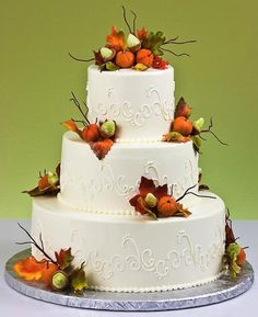 white fall autumn wedding cake with sugar pumpkin decors