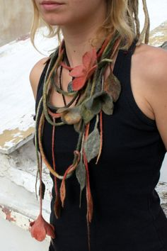 Earthly pastel colored from hand dyed wool felted flower necklace. It is hand…