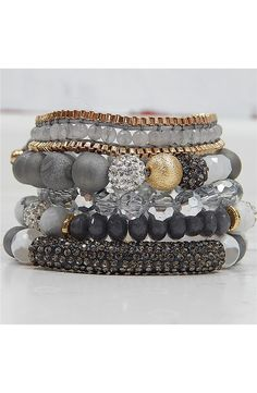 """- Beaded with seriously sparkling crystals and faceted stones, this set of five bracelets looks great styled as a stack or when mixed in with your other favorite pieces. - 2"""" stacked width. - 22k-gold"""
