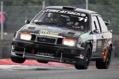 Ford Sierra Cosworth. Known in the U.S. as a Merkur XR4-Ti. Only we didn't get the Cosworth engines, just the crappy 2.3L Ford that was introduced in the early 70's in the Pinto. Ford was nice enough to add a turbo, but you can't polish a turd. Lol