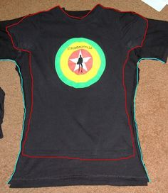 How to alter a men'st-shirt to a women's fit. Great for those otherwise unflattering concert t's and walk/run giveaways