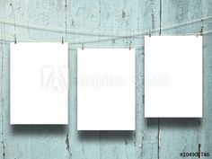 #Three hanged #blank #frames with pegs on weathered #aqua #wooden #boards #background