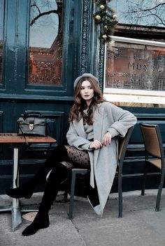 Lolita Masagutova looks sweet and feminine in this Parisian inspired outfit. She coordinates her grey beret with her coat. Her starry tights add an extra touch of whimsy for a casual street style look.  Jumper: H&M, Skirt: Zara, Beret: Topshop, Bag:...