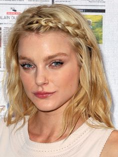 this chick looks cracky, BUT this exactly how I plan on getting through the rough part of growing out my bangs. for real.