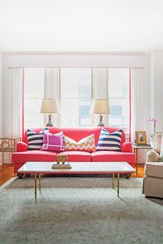 """For me, coral is a neutral,"" laughs textile designer Caitlin Wilson, who in nine fast months transformed a bland Philadelphia apartment into an upbeat, family-friendly space brimming with personality. Her secrets: trend-proof furniture, pops of color, and quirky secondhand finds, like the living room's classic coral sofa and sixties coffee table (an eBay score). The freewheeling mix gives the rental a collected-over-time hominess that ""makes us happy every time we walk in the door,"" says…"
