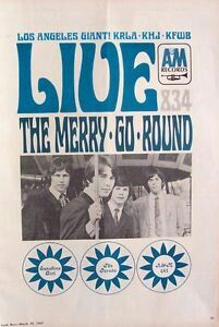 """1967 MERRY-GO-ROUND (EMITT RHODES) A&M-LA Radio Promo Poster. """"Live""""was their first single.. Covered by FAIRPORT CONVENTION the same year. MERRY-GO-ROUND Drummer BILL RINEHEART was also in GENE CLARK BAND in '67 touring for his first LP w/GODSIN BROTHERS."""