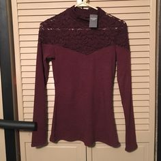 Abercrombie Mock Neck Top Burgundy top from Abercrombie & Fitch. Beautiful lace detailing across top. Can dress up or down. Size small. Brand new with tags; perfect condition. Retails for $44. Abercrombie & Fitch Tops Blouses