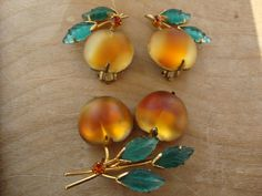 Vintage Austria Double Frosted Glass Fruit Peach Brooch/Pin And Earring Set - The brooch is on a gold tone stem with three green molded glass leaves that are in great shape and one orange rhinestone on the stem. The clasp is a rollover and the brooch is signed Austria on the back of the fruit. Z