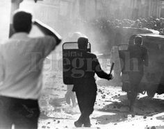 Riots : Belfast. August 1969.  Police with batons drawn rioters on Belfast's 'protestant' Shankill Road area.  (3/8/69)