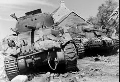 """Canadian tank M4A4 """"Sherman"""" M4A4 of the South Alberta Regiment and destroyed tank Pz.IV. 
