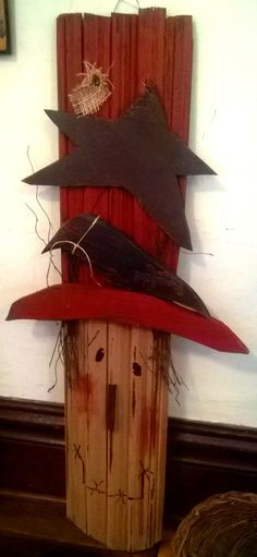 Primitive hand crafted wood scarecrow head.